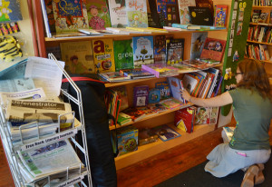 A customer browsed in the children's stacks at Bindlestiff Books.