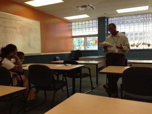 Assistant Center Director LaShawn Braxton addresses parents' concerns.