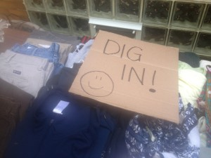 Sign encouraging visitors to rummage through yard sale bargins