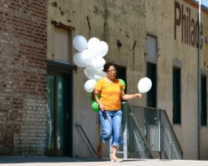 A woman was about to release a white balloon to symbolize the loss of a loved one.
