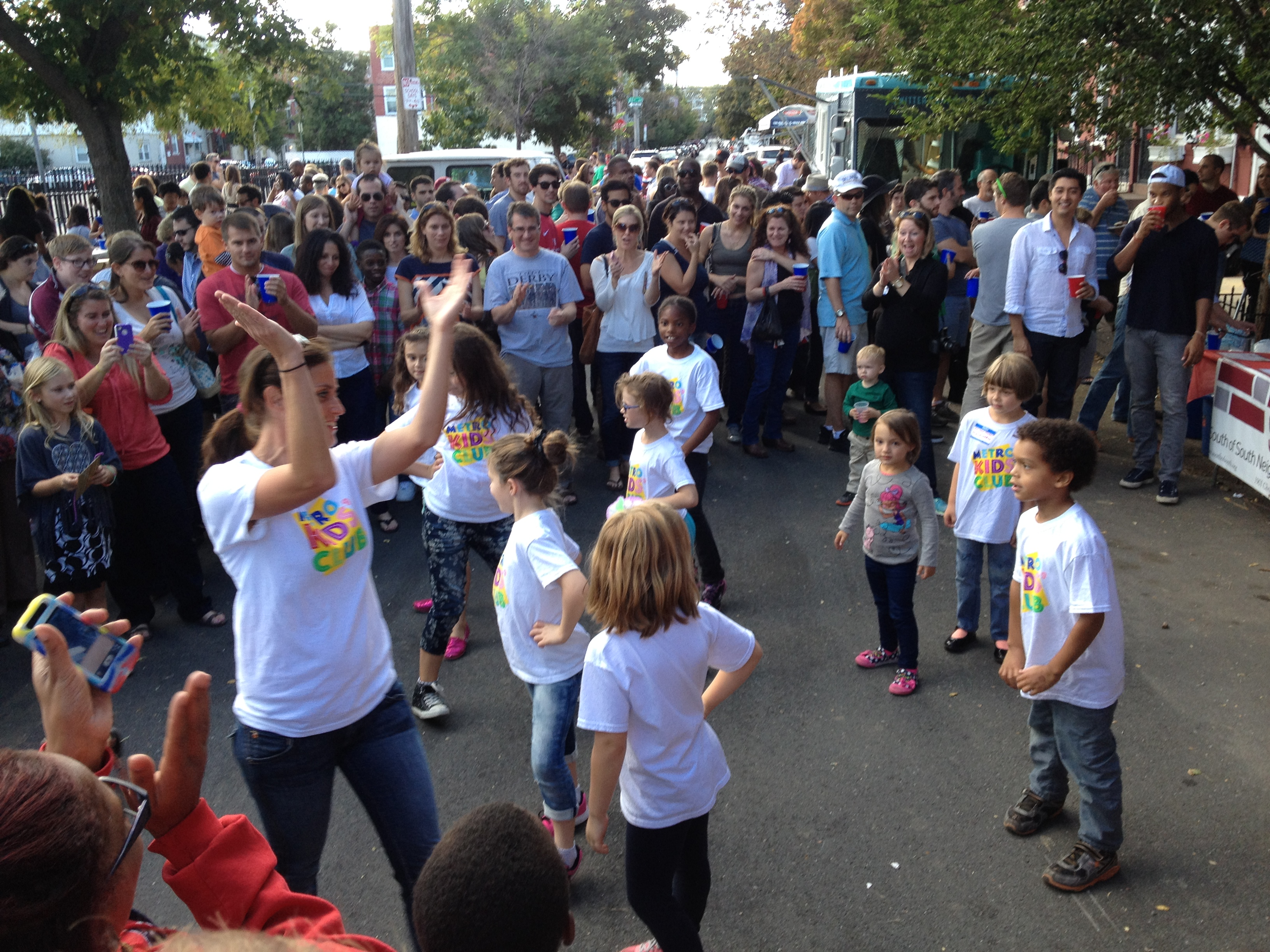 The Metro Kids Club entertains the crowd with a dance routine.