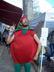 Elliott Ridenour dressed as a tomato to promote the restaurant at the race. He had worked hard to convince the restaurant to let him put his mascot experience to work.