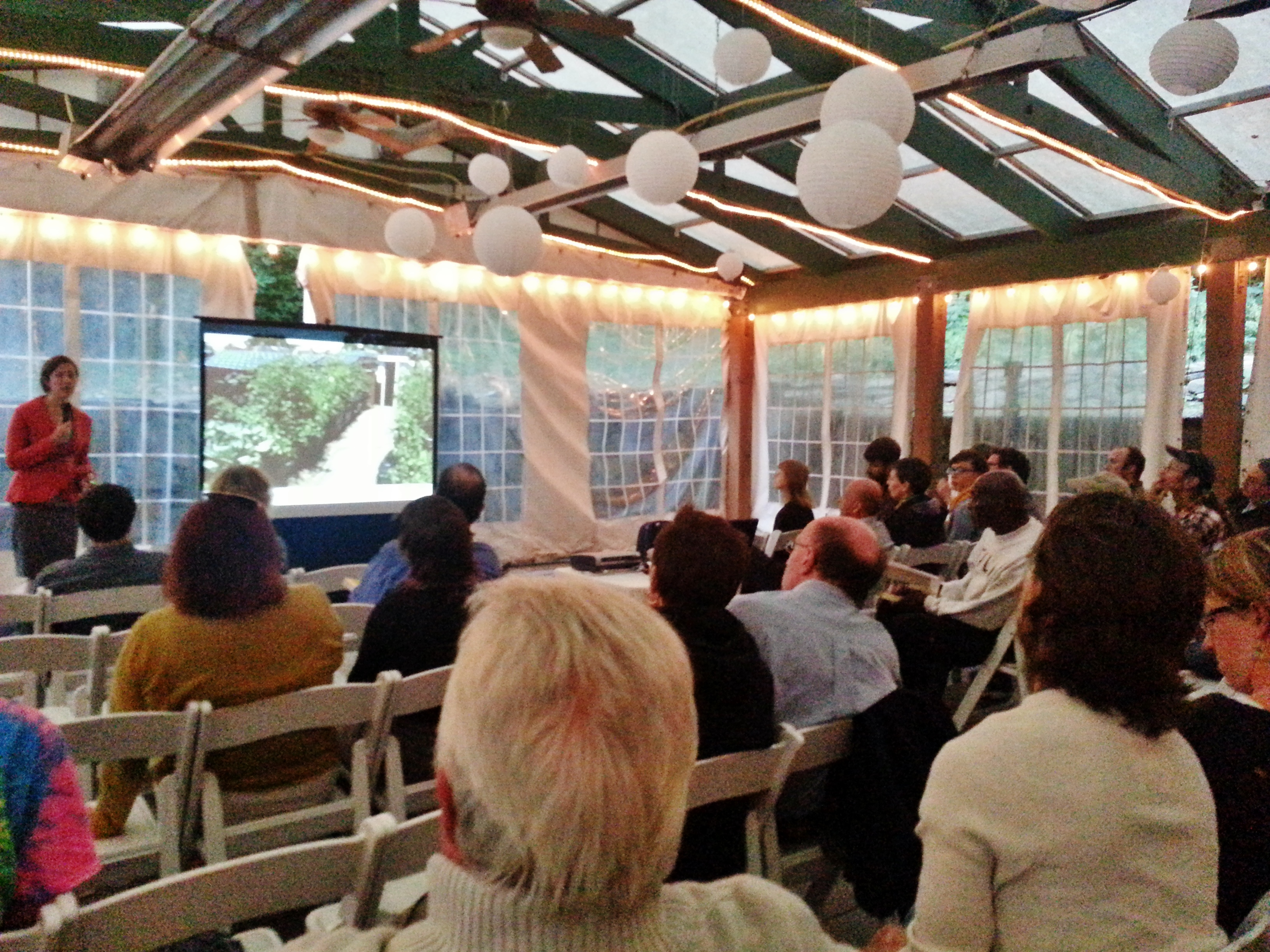 A group of attendees interested in rooftop agriculture gathered at the outside venue of the Green Valley Inn.