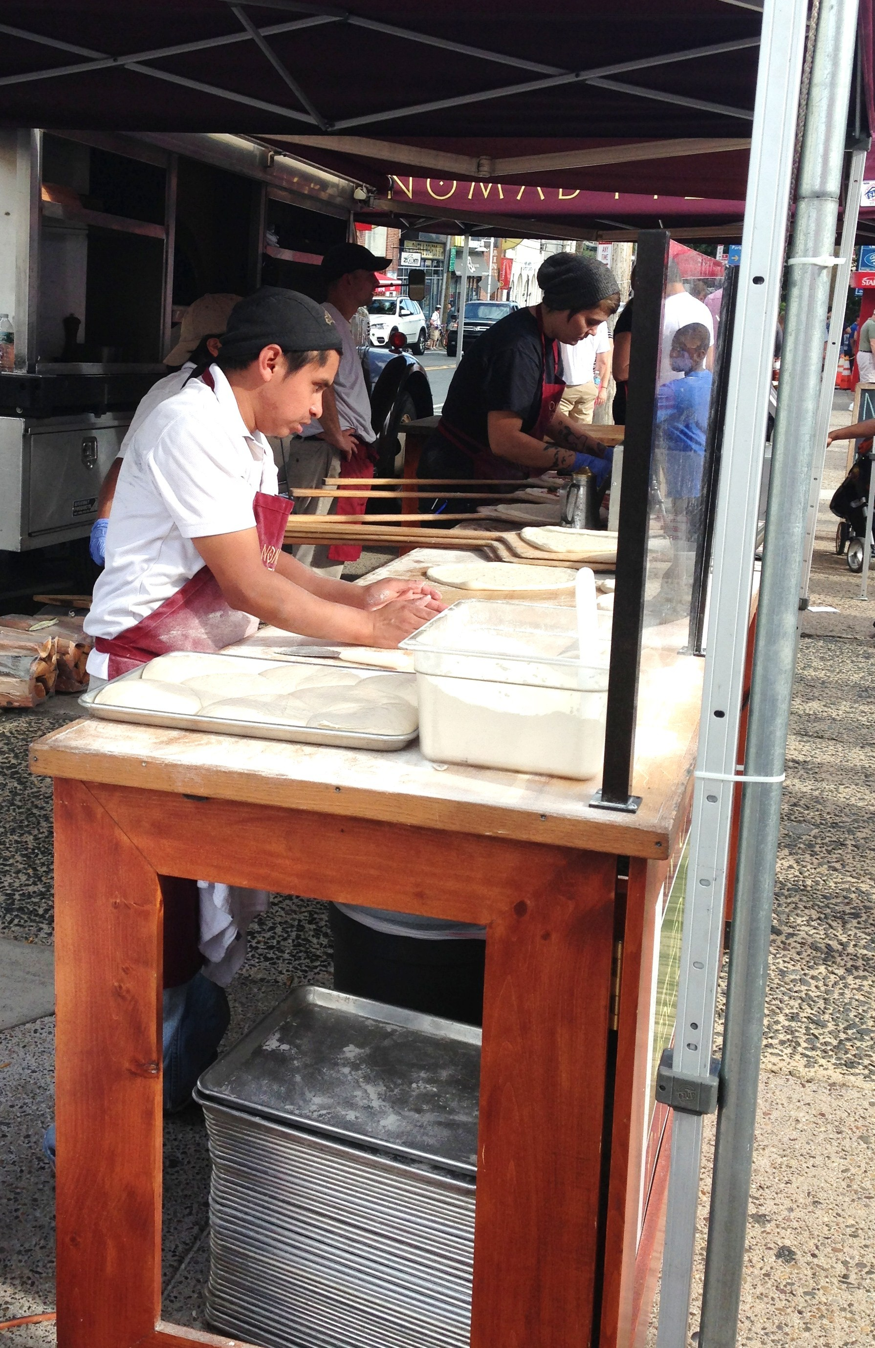 Nomad's Pizza made fresh pizza at Manayunk's Streat Food Festival.