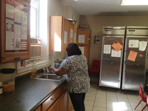 Rashonda Steed, an employee at Baring House wiped down the kitchen after she gave the children a snack.