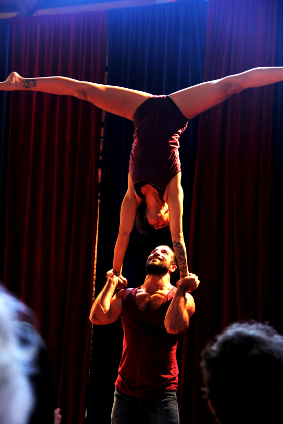 Daniel Stern and Cole Della Zucca demonstrate hand to hand acrobatics.