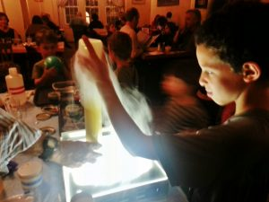 A child patron at Earth explores the dry ice experiment.
