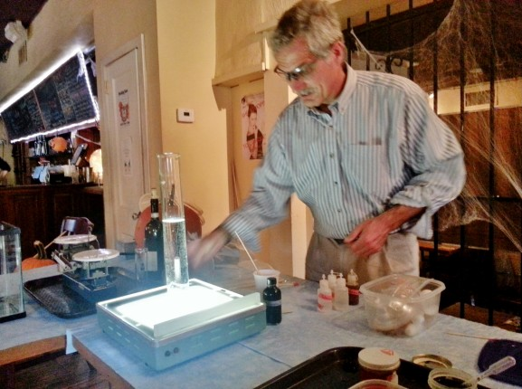 Dr. Fred Schaefer prepares his table of Halloween themed chemistry demonstrations at Earth.