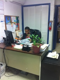 Secretary, Zakirah works diligently at her desk.