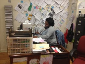 Case Manager Ashanta Walter answered phone calls and took care of paperwork while in her office.