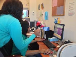 Site Coordinator, Jakasha Johnson (left) helped Sherita Hogan log into their system.