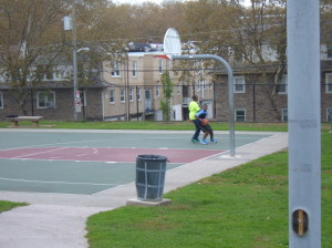 Neighboring Olney youth play a game of basketball at Fisher Park's basketball court