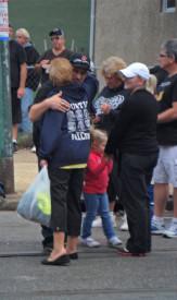 Event-goers embrace on Richmond Street.
