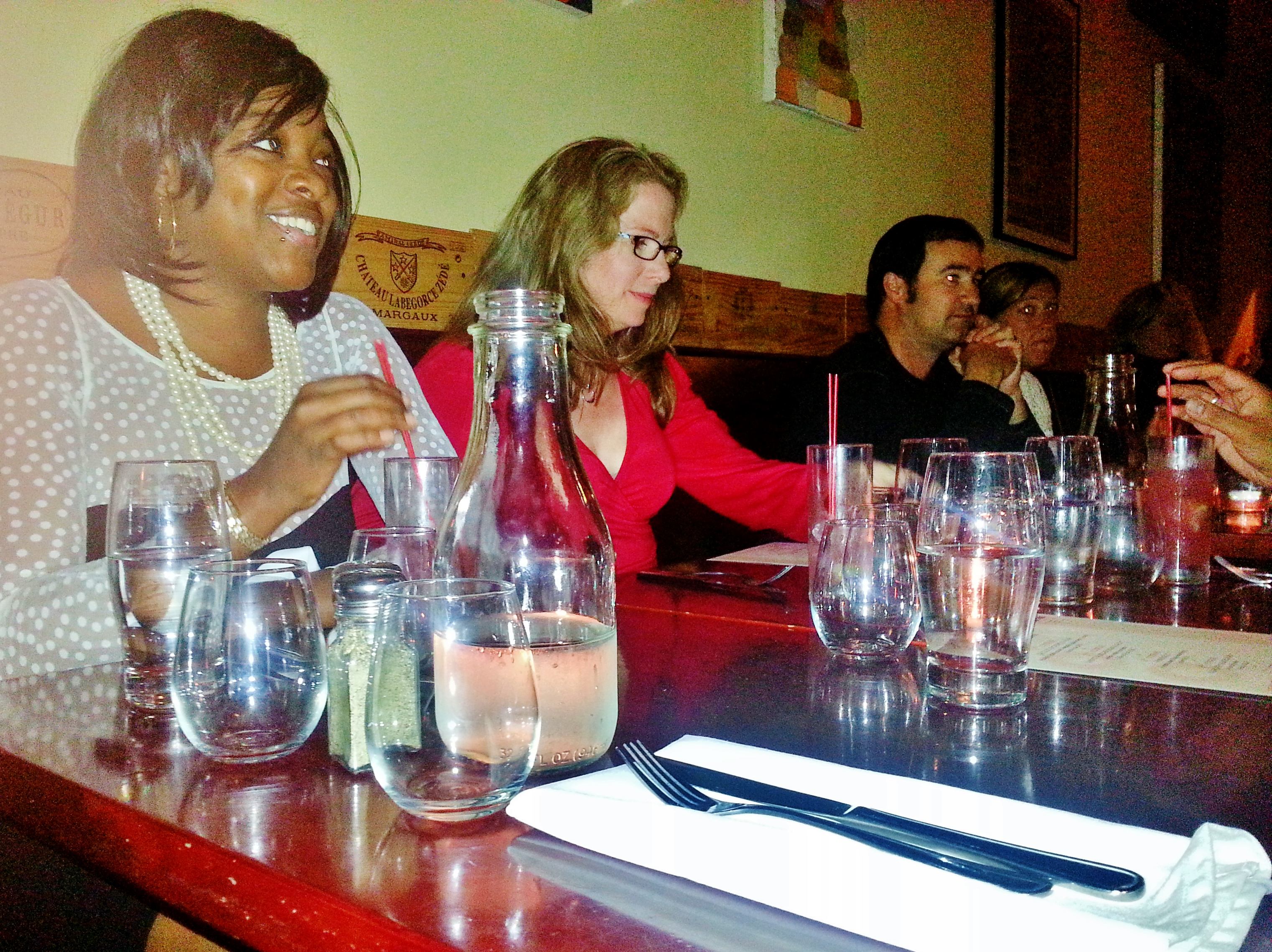 Customers enjoy the atmosphere while waiting for their food and wine.