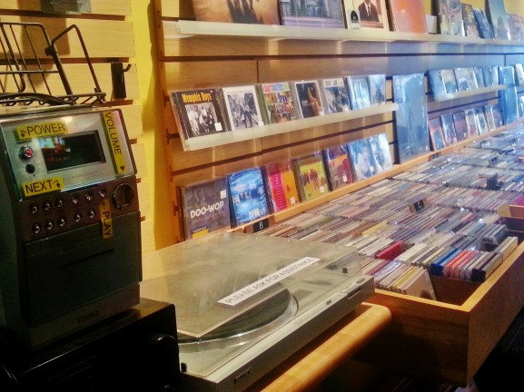 Decades of music are represented at Hideaway Music through items such as a vintage record player and CD albums.