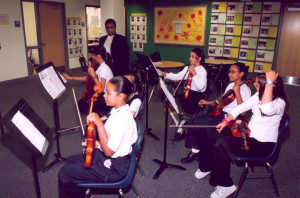 Students in the music program perform at Penn Alexander's Ribbon Cutting and Naming Ceremony, Oct. 7, 2002 (courtesy of UPenn Archives)