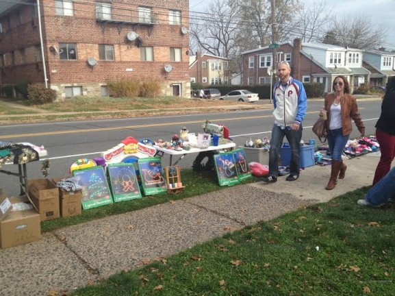 Neighborhood residents stopped by Cioccia's yard sale on their walks home.