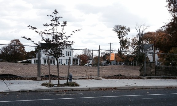 A fenced in empty lot at Roxborough and Ridge Avenues awaits a new Wendy's.