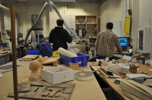 NextFab members work on projects in the wood shop.