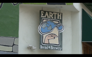 The sign out front of Earth: Bread & Brewery.