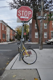 A Graduate Hospital resident's bike safely locked to a stop sign