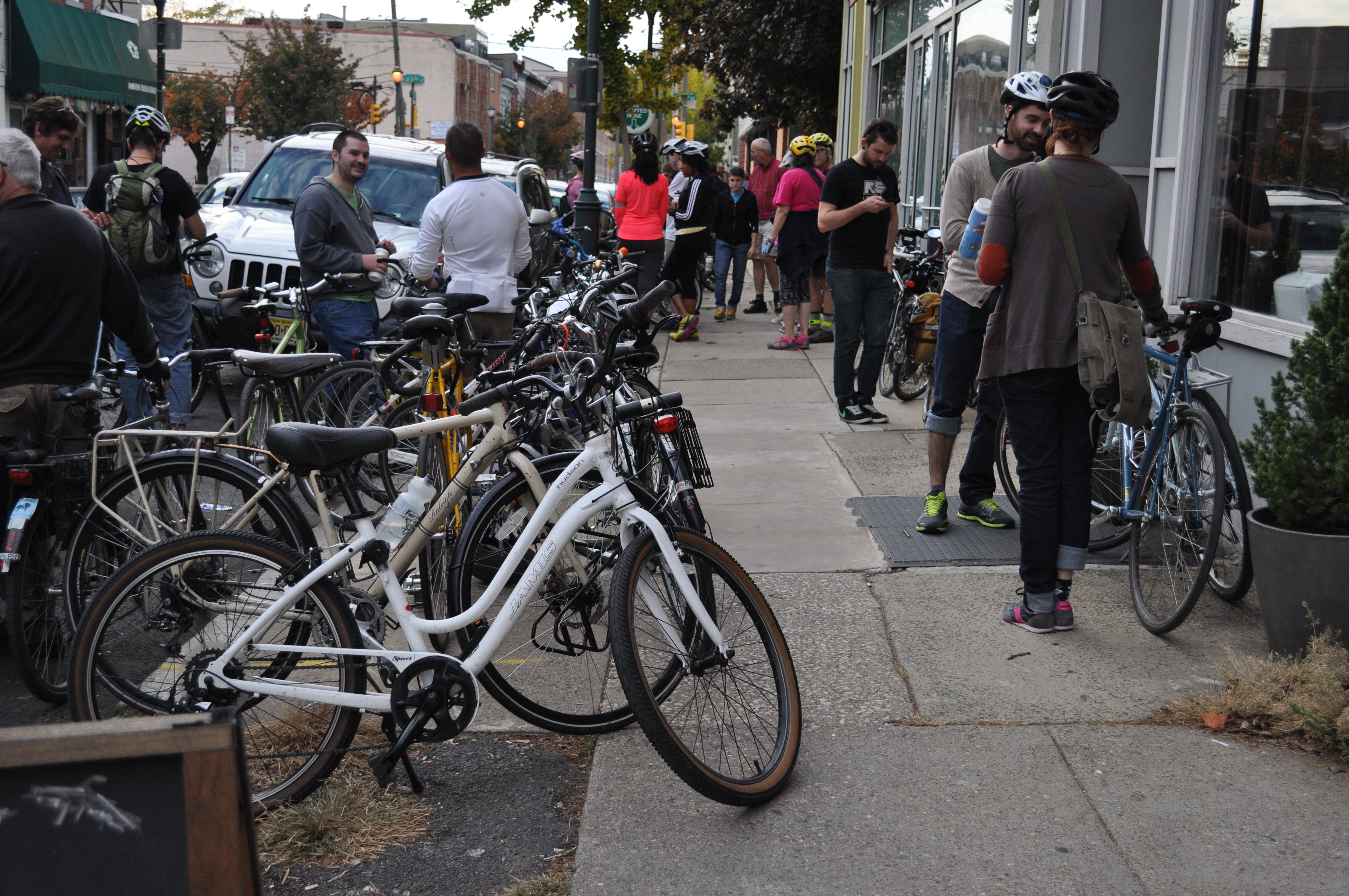 Graduate Hospital residence gather outside of their local bike shop, Bicycle Therapy.