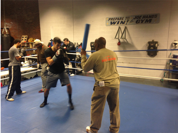 """Amateur boxer Chris Sanchez trained in a practice session with longtime boxing trainer Stanley """"PeeWee"""" Dawson."""
