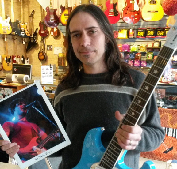 DiPinto displayed a photo of Jack White playing one of his guitars.