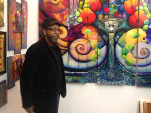 James Dupree in front a new piece of his which he plans to make look 3-Dimensional.   Photo: Patrick McPeak
