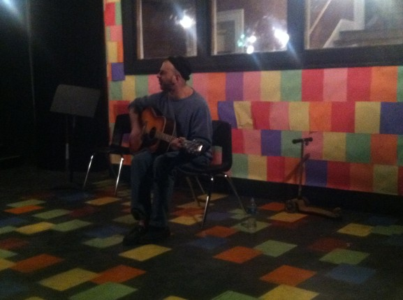 Larry Sherby plays guitar at the Curator Theatre Company open mic on Friday, February 7.