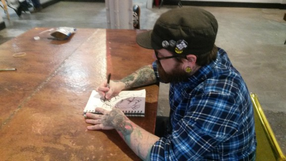 Tim Pangburn drew a sketch at Art Machine Productions.