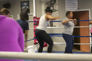 Instructor Brittani Warner demonstrates one of the class' exercises.