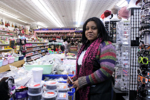 Andrea Matthews, a sales associate at Thrifty Beauty Shop & Discount Store, located on the 2800 block of Girard Ave. in Philadelphia, on Monday, March 24, 2014.