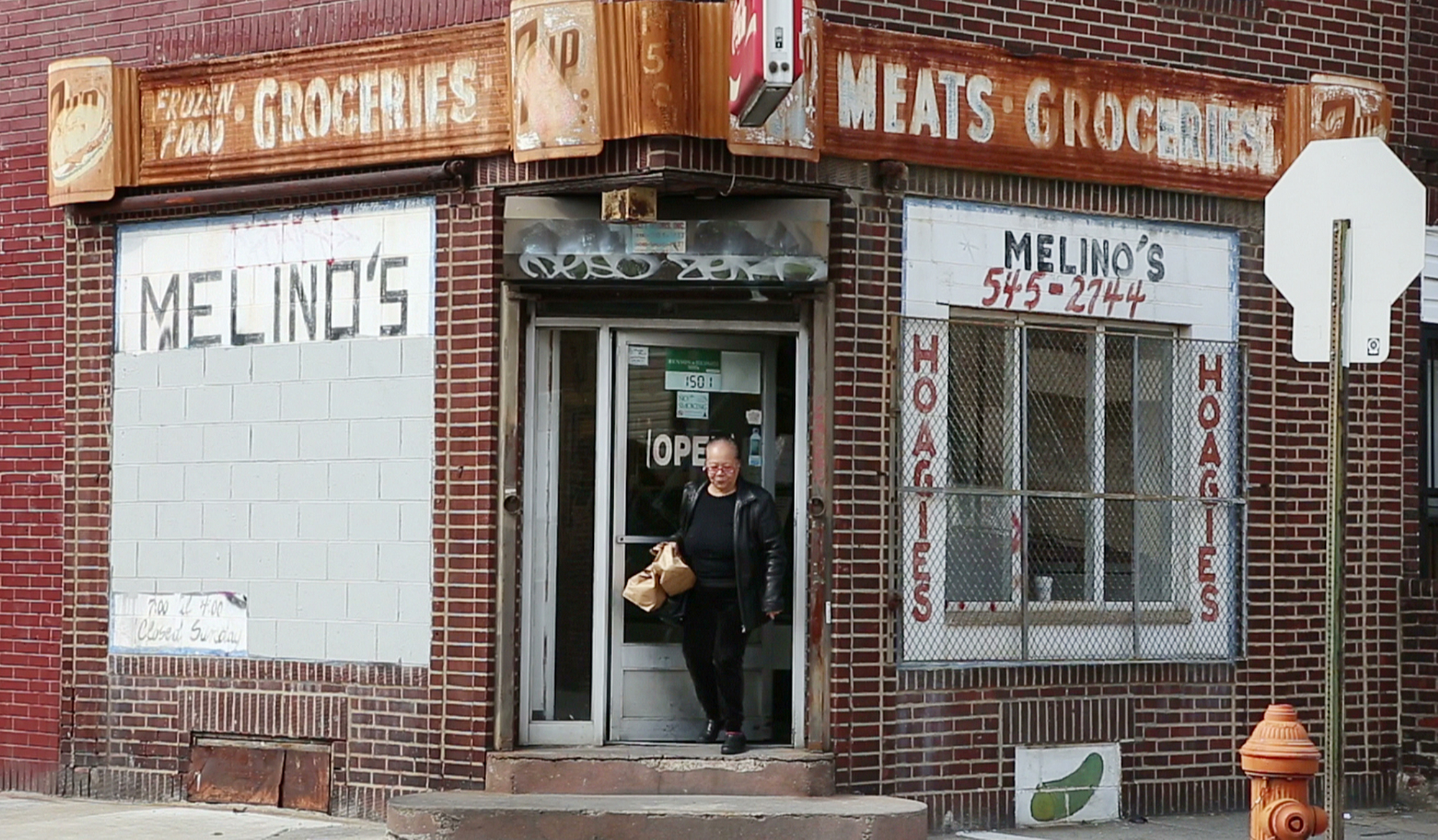 A customer exits Melino's Hoagie shop on the 1100 block of South 15th Street, March 20, 2014.