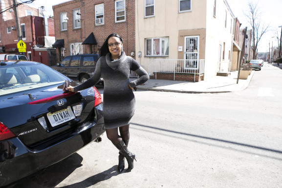 Carmen Russ with her car, parked in front of the home she grew up in.