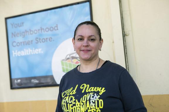 Clara Esantos, in front of her neighborhood grocery, Oliveras.