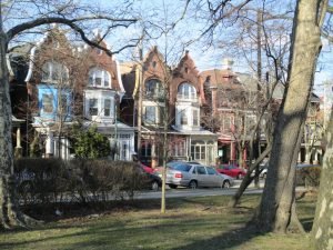 Homes on Baltimore Avenue, facing Spruce Hill's Clark Park. Many of these homes belong to single families or are rented by University of Pennsylvania students.