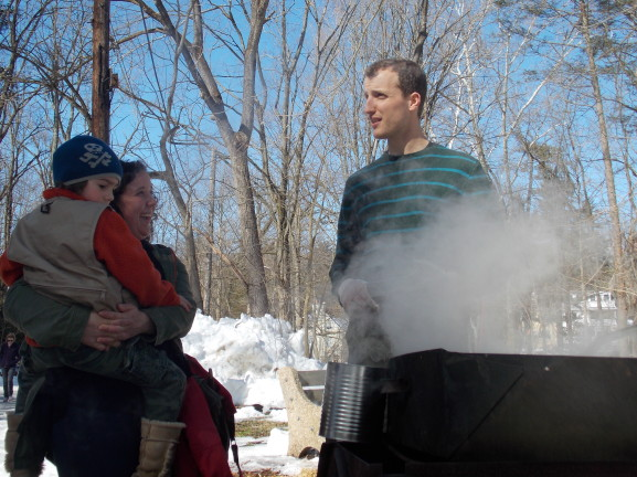 Alia Thompson and son, Ben, learn about sap and the evaporation process.