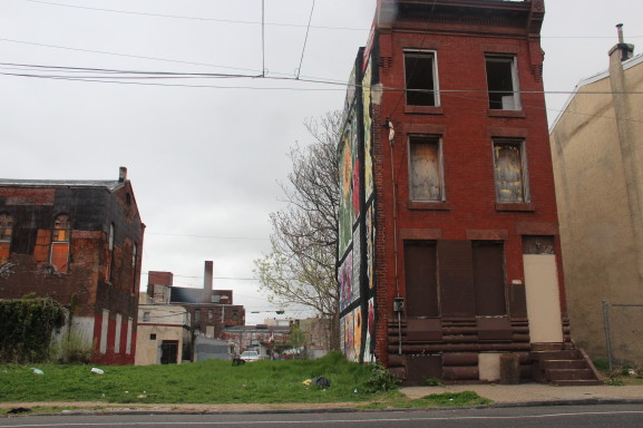 This house is now boarded up after being abandoned by Fairhill residents.