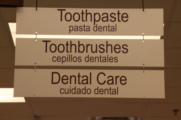 The signs for the Aisles in the local Rite Aid bear both the English and Spanish Language.