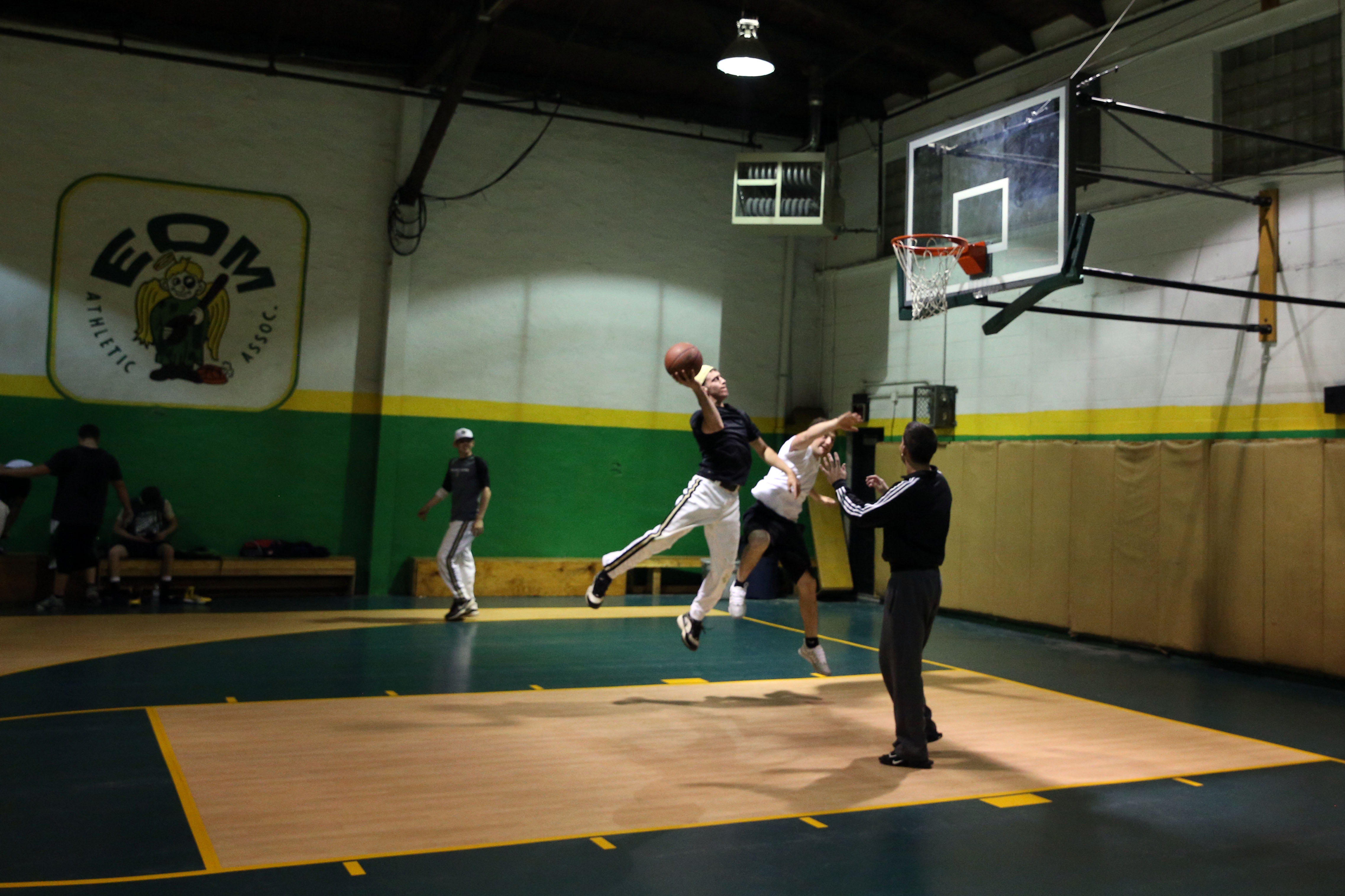 A young men's league plays basketball in the gym