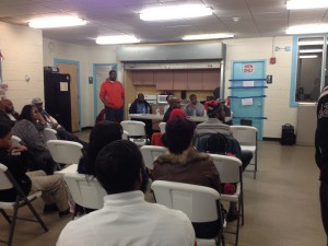 Co-founder Donnell Regusters speaks to town hall meeting attendees