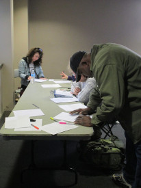 Prospective actors and actresses sign in to rehearsal