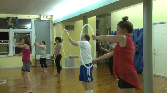 Students participated in a hooping class offered by Philly Yoga Factory.