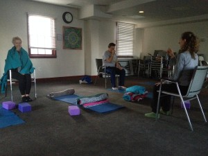 Stortz instructs her students on breathing techniques.