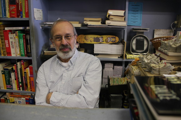 Bookhaven co-founder Rolf Andeer sits at the checkout/reading area.