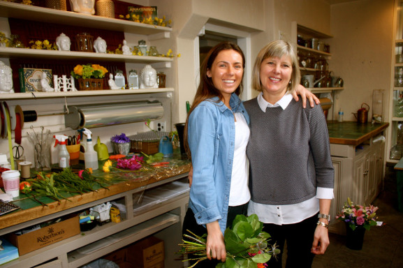 Owner Sandy Robertson (right) works with her daughter Sarah, the fifth generation of Robertson family to work at the florist on Germantown Avenue.