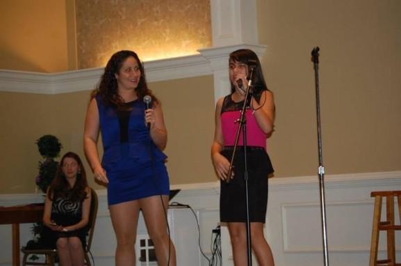 Cristina Elena Guzman helped a student perform onstage.