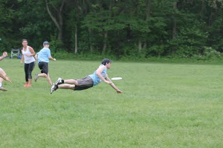 Dan O'Hara makes a diving catch while playing Ultimate Frisbee.