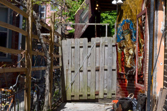 Behind this innocent looking gate is a maze of murals and sculptures that make up the Tiberino museum.
